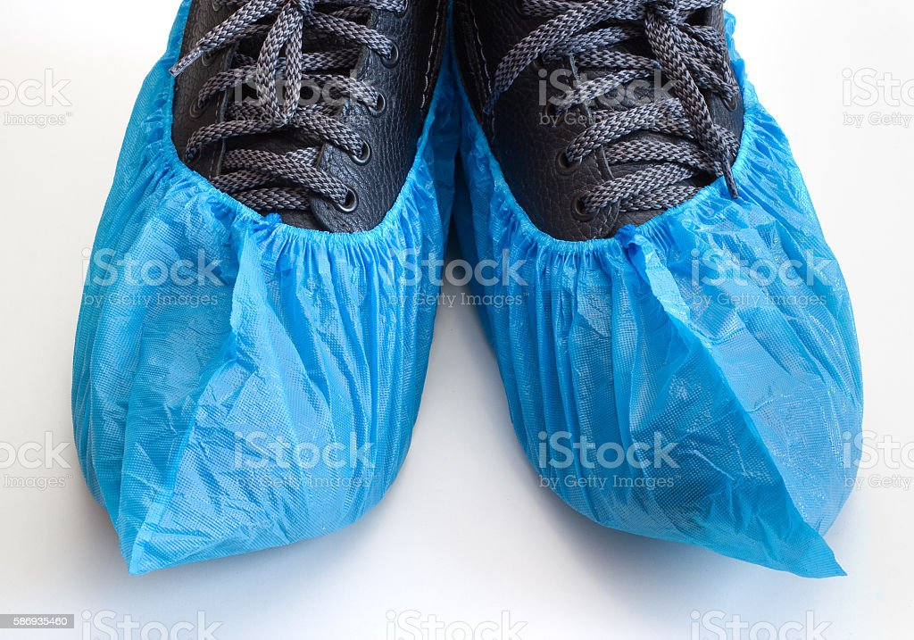 Blue overshoes on the boots stock photo