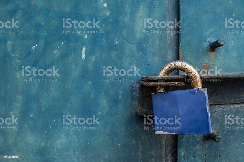 Blue padlock on steel door. stock photo