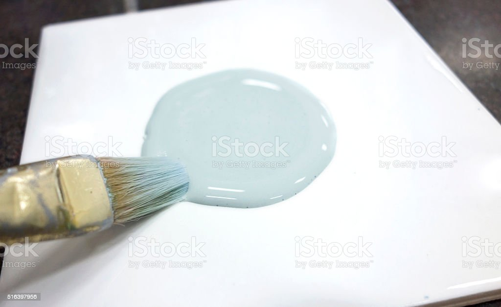 Blue Paint and Brush on Tile for Pottery Painting stock photo
