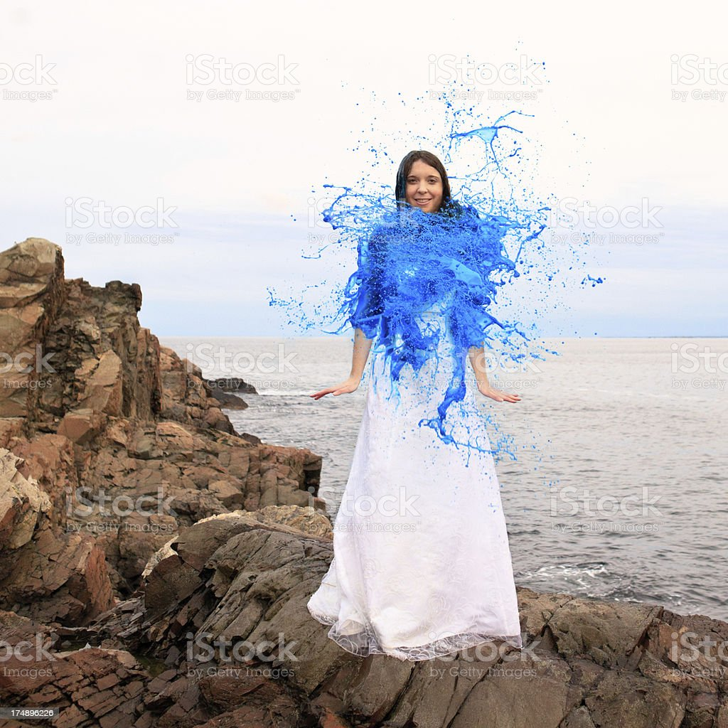 Blue paint forming a fluffy shrug around bride stock photo