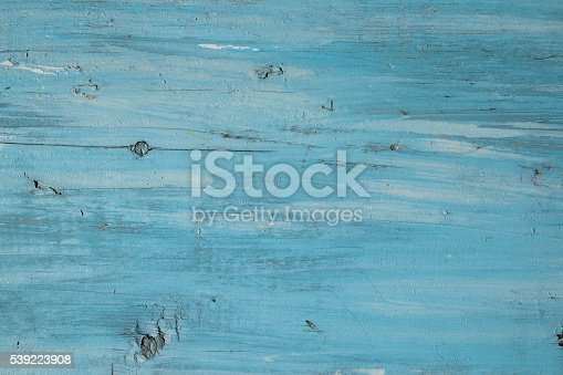 istock Blue paint on a wooden board use for background 539223908