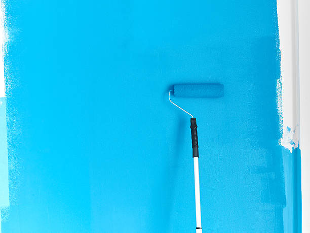 Blue paint on white wall stock photo