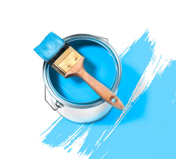 Blue paint tin can with brush on top on a white background with Blue strokes stock photo