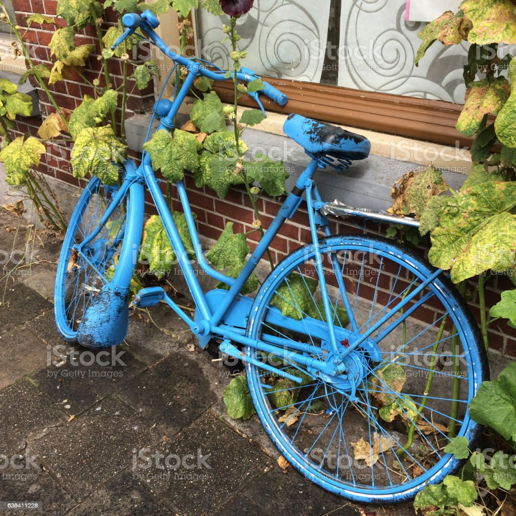 Blue painted bicycle stock photo