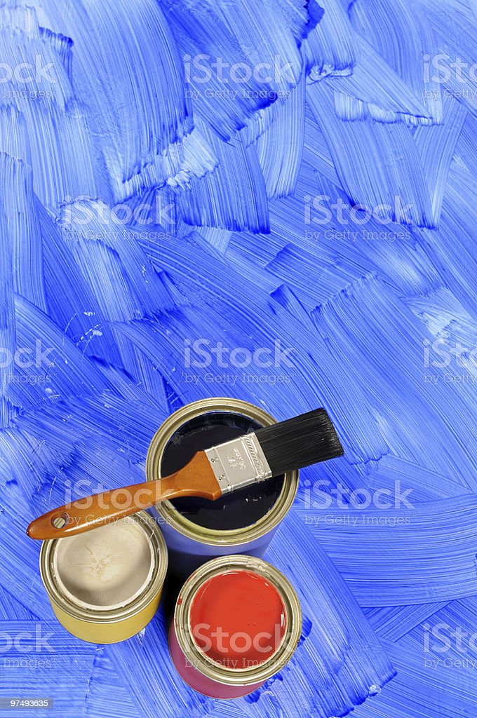 Blue painted floor with paint tins royalty-free stock photo