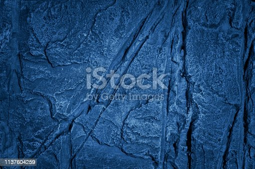 1169630303istockphoto Blue painted stone wall texture 1137604259
