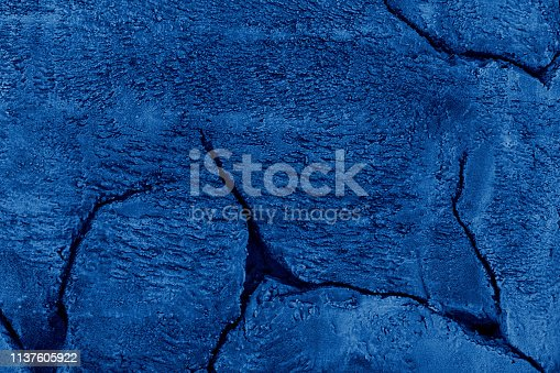 1169630303istockphoto Blue painted stone wall texture 1137605922
