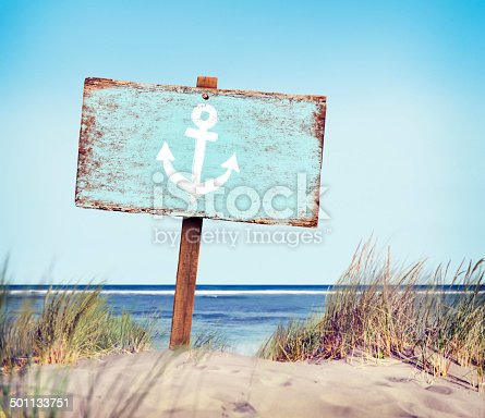 istock Blue Painted Wood Label on the Beach 501133751