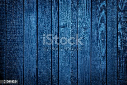 Wood planks panel blue converted and vignetted by Photoshop.