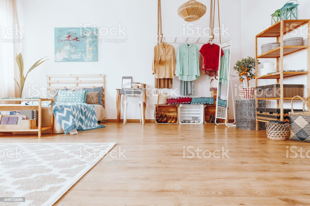 Blue painting above king-size bed stock photo