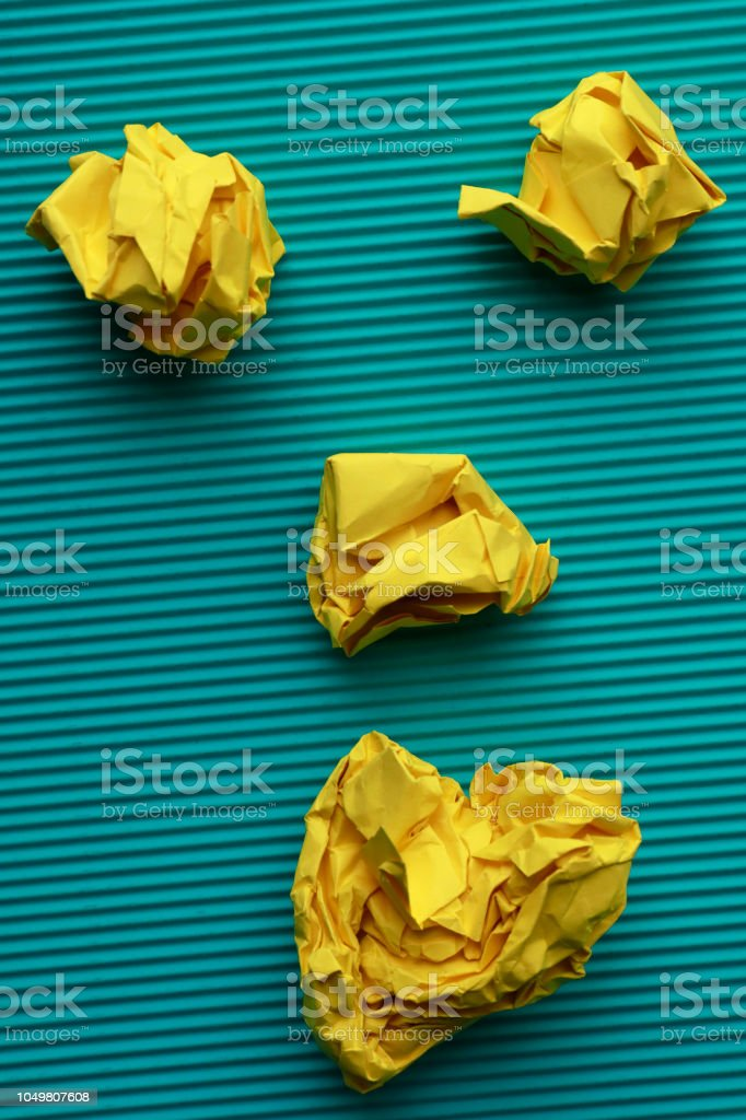 Blue paper and yellow paper ball