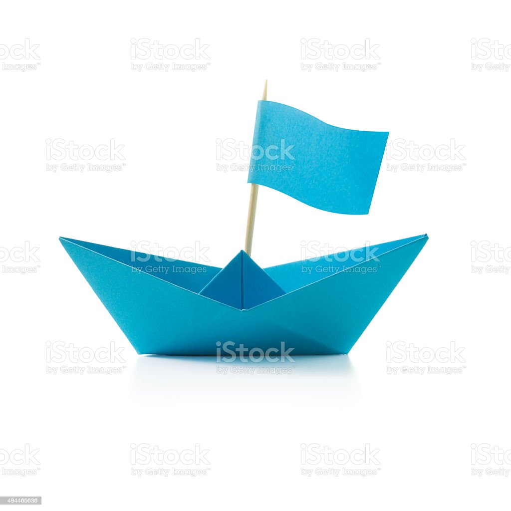 Blue paper boat with flag stock photo