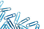 Close-up of blue paper clips isolated on a white background. High resolution - 46 megapixels. Space for copy.