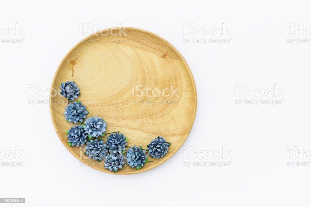 Blue paper flower on round wooden tray royalty-free 스톡 사진