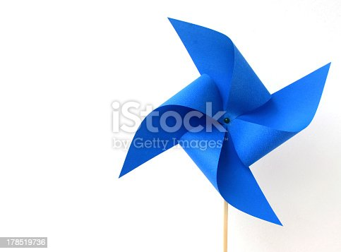 istock A blue paper windmill on a white background 178519736
