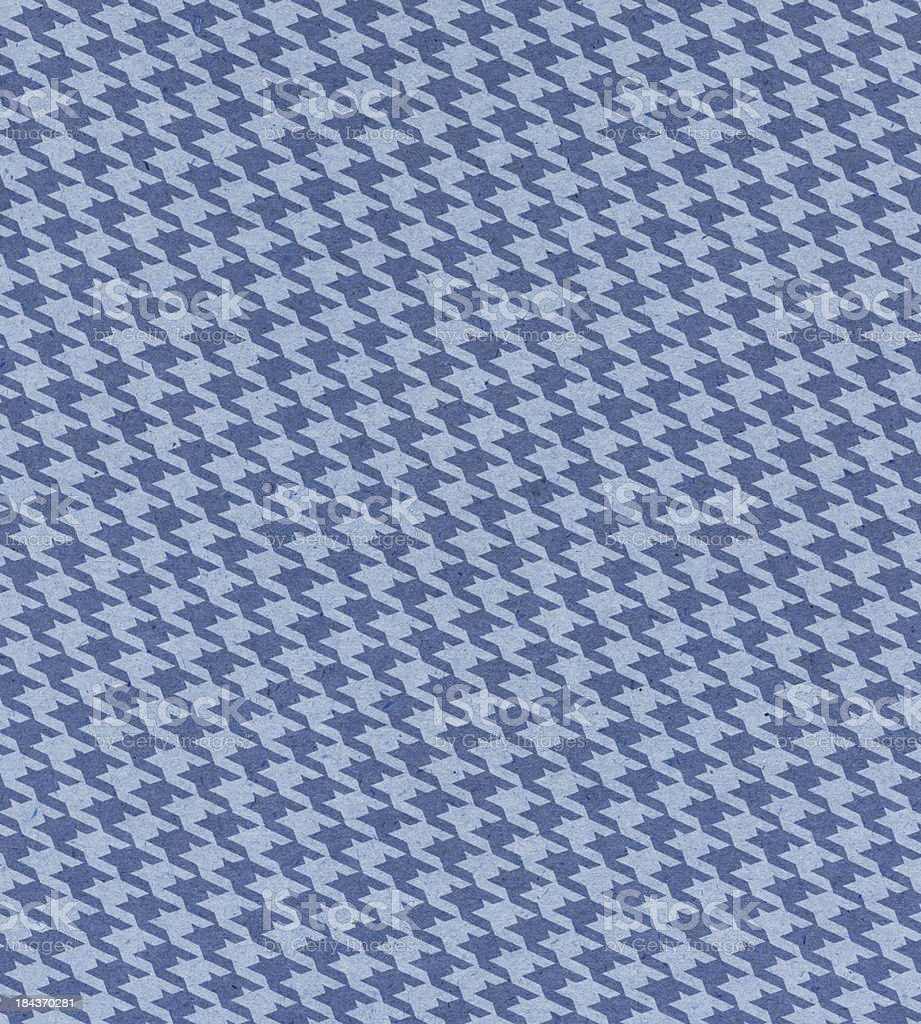 blue paper with houndstooth pattern stock photo