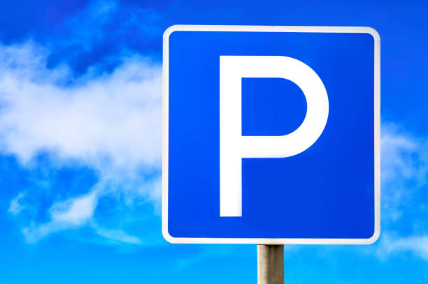 Blue parking sign against blue cloudy sky background. Blue parking sign against blue cloudy sky background letter p stock pictures, royalty-free photos & images