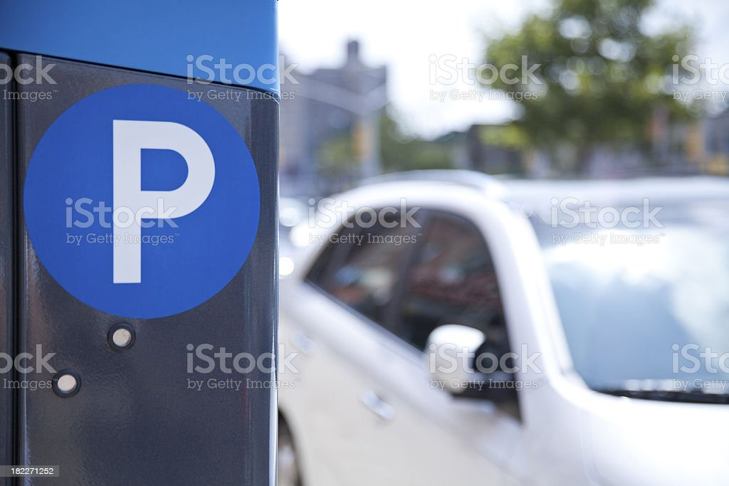 A blue parking ticket machine beside the road  stock photo