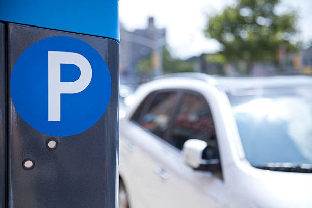 a blue parking ticket machine beside the road  - paid stock pictures, royalty-free photos & images