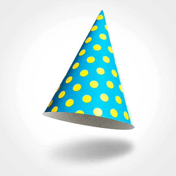Blue party hat in air, yellow spots isolated on white stock photo