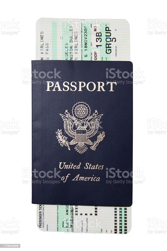 Blue passport with a white and green boarding pass stock photo