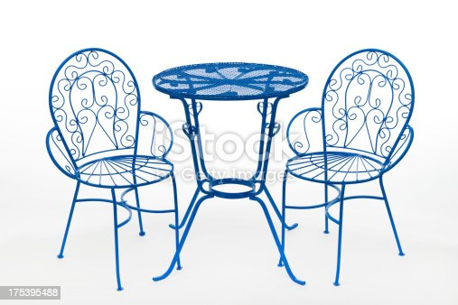 This image shows a blue wrought iron patio chair and table set on a white background.