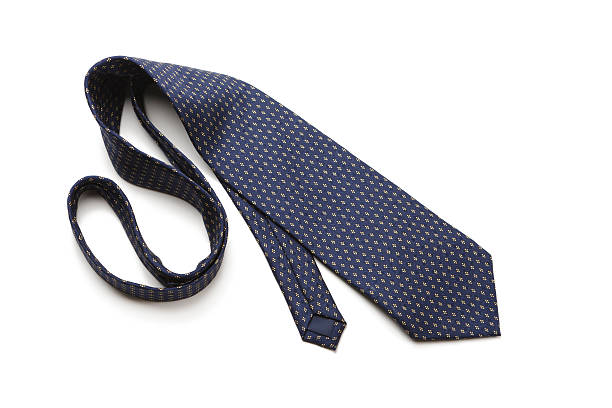 Blue patterned necktie laying on white background stock photo