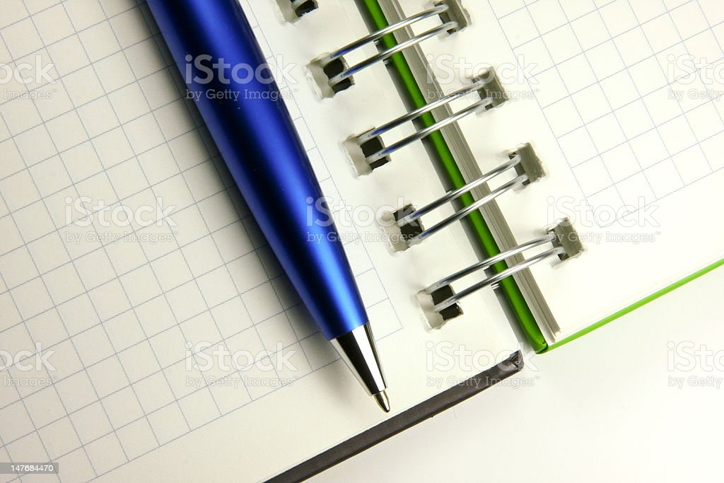Blue pen on a notebook stock photo