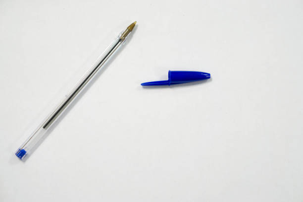 blue pen on white background stock photo