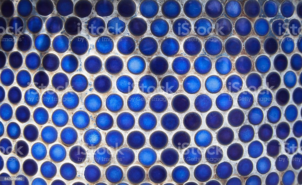 Blue penny circular ceramic tiles background. Tiled bathroom wall stock photo