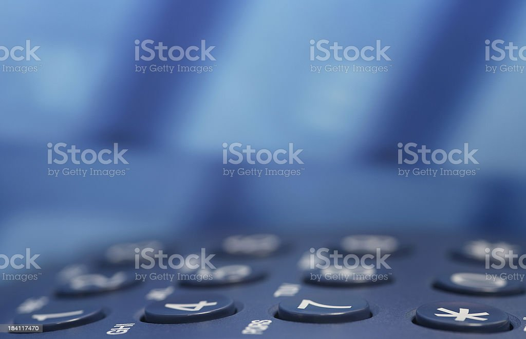Blue Phone Keyboard in a Business Center royalty-free stock photo