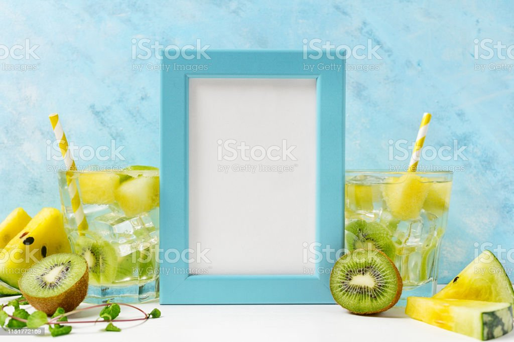 cool and fresh kiwi watermelon lemonade with ingredients on blue...