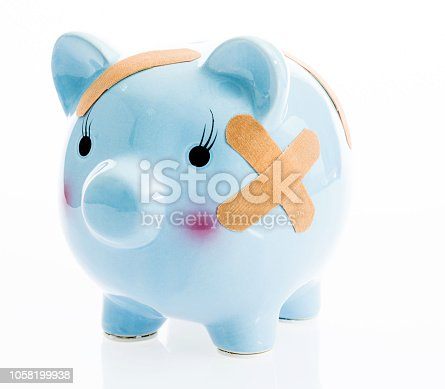 Blue piggy bank with band aids.