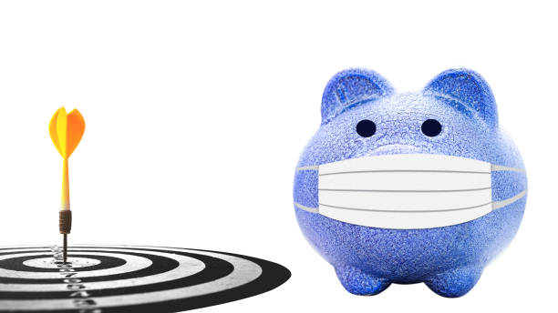 blue piggy bank  with dart target arrow isolates on white background stock photo