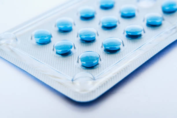Blue pills Small blue pills in a blister pack oestrogen stock pictures, royalty-free photos & images