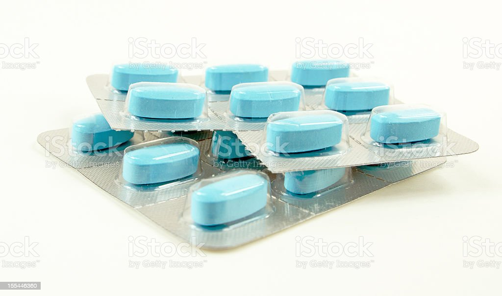 Blue Pills Sealed in Plastic stock photo