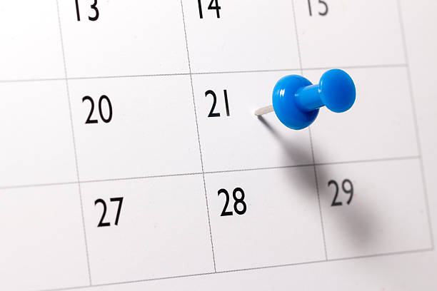 Blue pin on Calendar stock photo