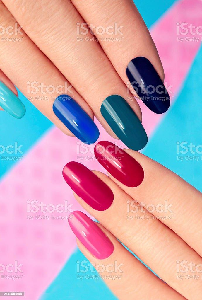Blue pink nail Polish. stock photo