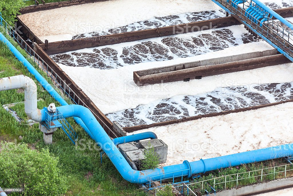 Blue pipelines with oxygen supply for water aeration, industrial plant stock photo