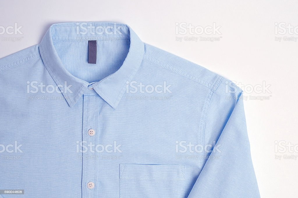 Blue plain cotton shirt White background - foto de stock