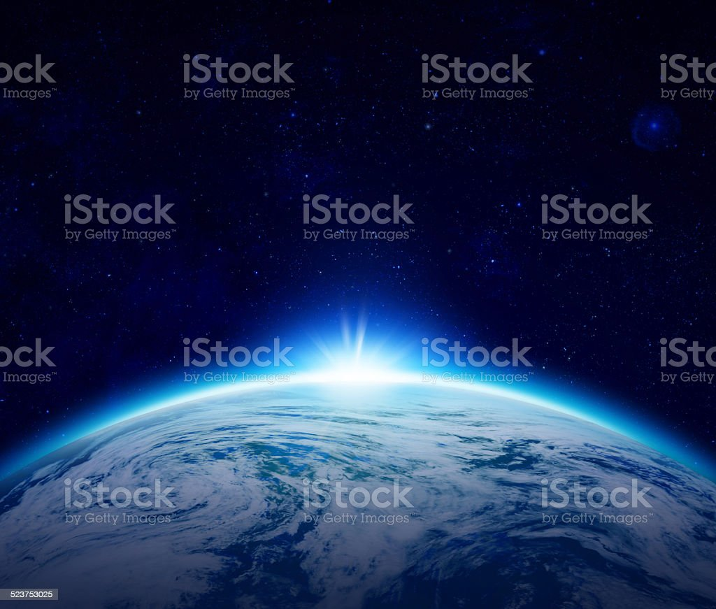 Blue Planet Earth sunrise over cloudy ocean with stars stock photo