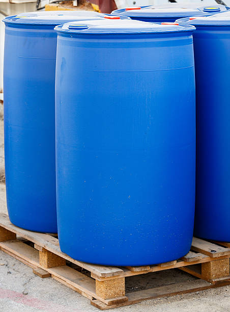 Blue plastic barrels on pallet stock photo