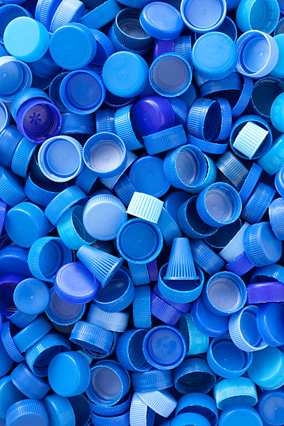 blue plastic caps background - plastic cap stock pictures, royalty-free photos & images
