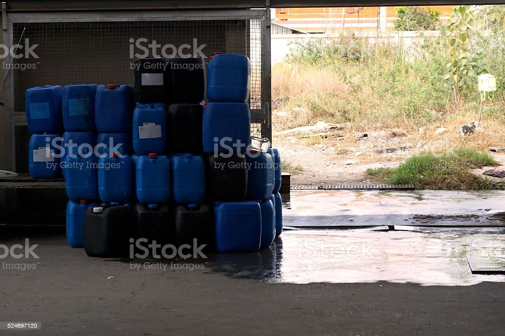 blue plastic chemical tank stock photo