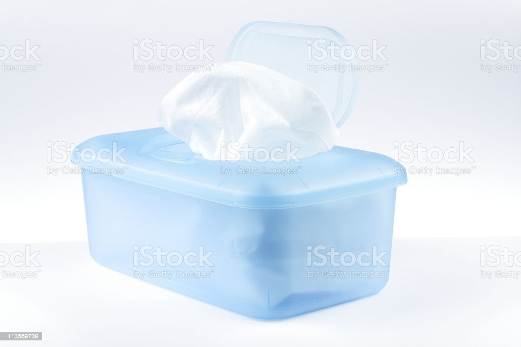 Blue plastic container filled with wet wipes stock photo