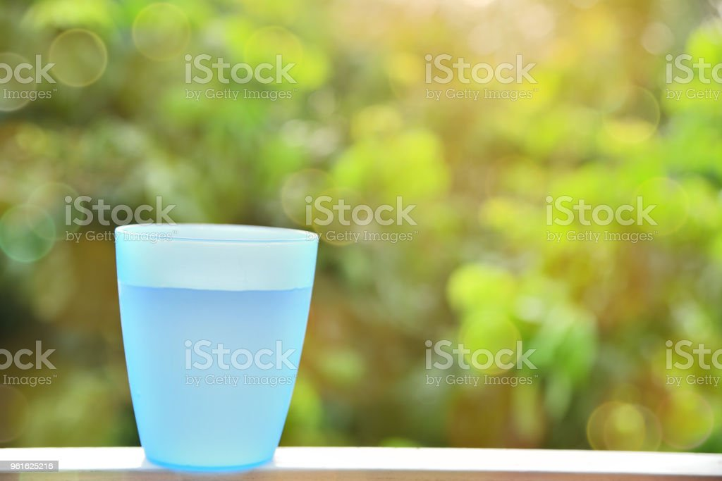 Blue plastic cup with water inside. stock photo