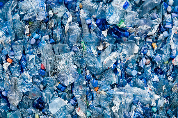 blue plastic garbage - plastic stock pictures, royalty-free photos & images