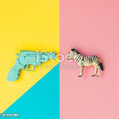 istock blue plastic gun gets shot the wild african zebra. 914751384