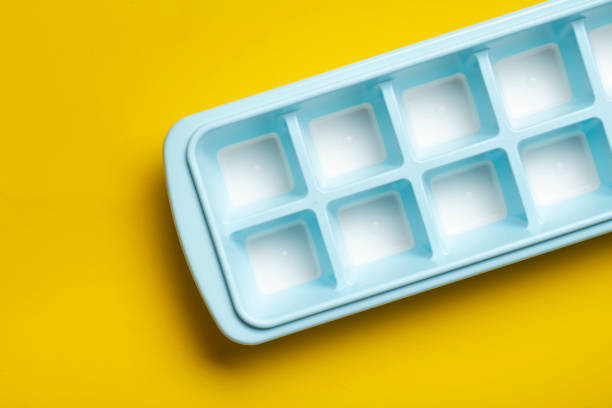 Blue plastic mold for making ice cubes for use in cocktails. Space for text. stock photo