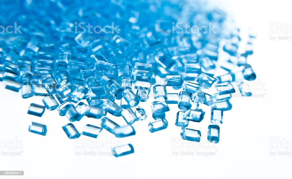blue plastic polymer granules stock photo